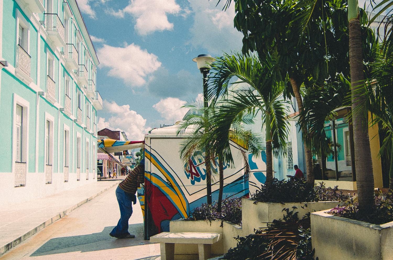 CIenfuegos Cuba Man legs street stall