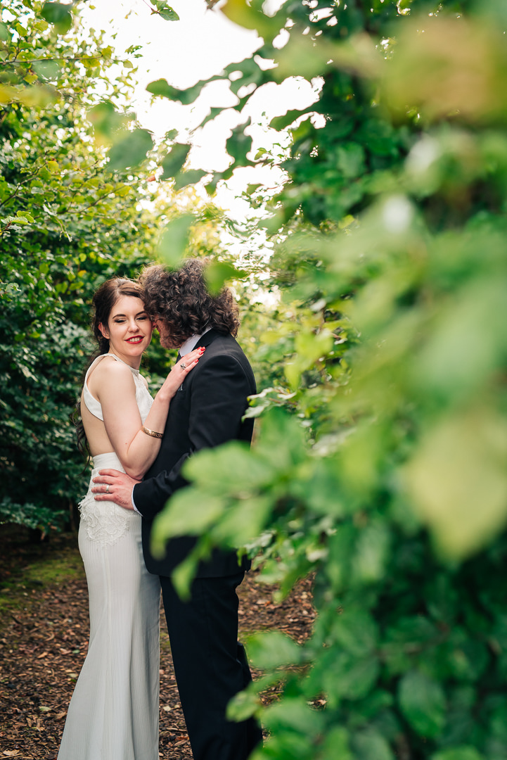 Irish wedding. Bride and Groom. Couple in green leafy area. Reviews of wedding photographer Ireland. Mount Druid Alternative Weddings.